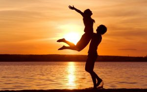 beach-sunset-couple-joy-female-in-air_smaller