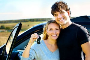 young couple car keys